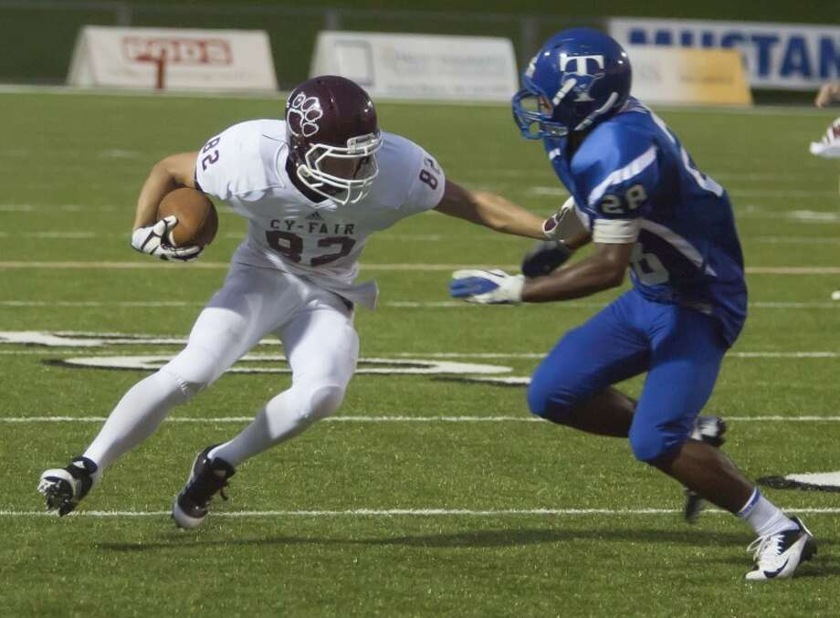 Cy-Fair's Price Colestiff arms a Katy Taylor player at Jack Rhodes Memorial Stadium. The Bobcats hopes to keep up their winning ways against Langham Creek in Week 3. Photo: Karl Anderson