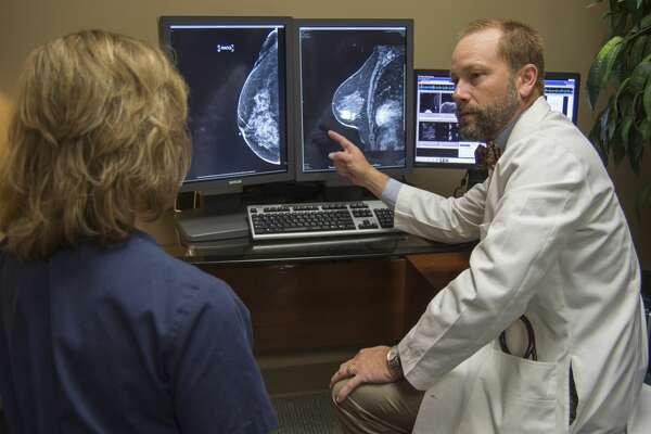 Dr. Noah Wempe, director of Allison Women's Imaging Center, talks with nurse Charliss Rogers about a patients MRI scan Thursday 09-29-16. Tim Fischer/Reporter-Telegram
