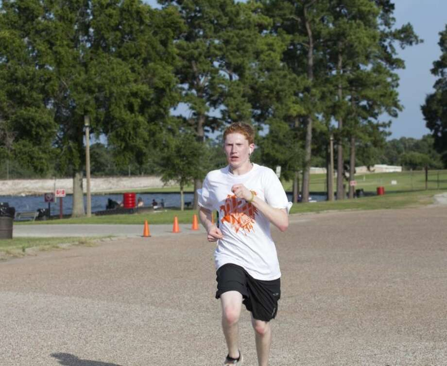 Alexander Hales, 18, of Humble won the 5K. He trained as a member of the cross-country running team at Atascocita High School and came to support his former troop at the event.