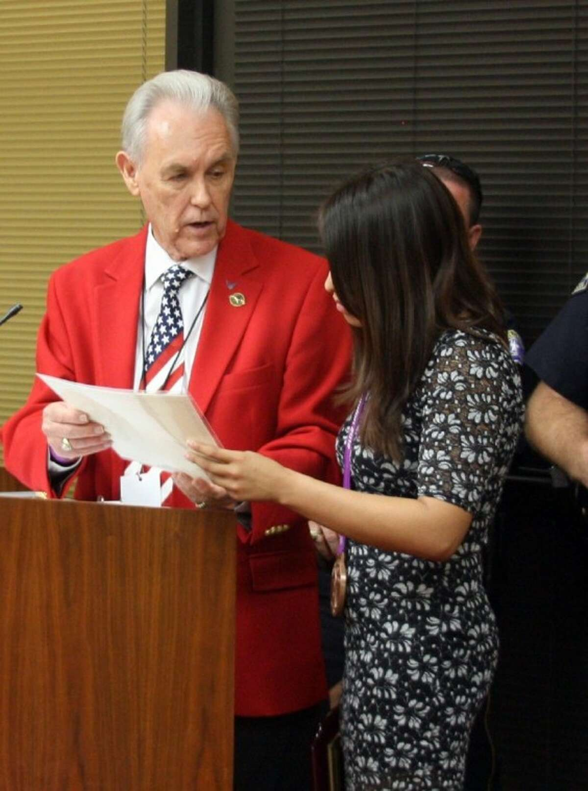 Richard Scott, director of community relations in Pasadena, is shown with Olympic medalist Marlen Esparza during an awards ceremony at a City Council meeting in 2012. On Tuesday, Scott testified in a voting rights lawsuit that he regretted breaking state ethics laws.