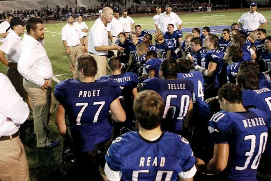 Friendswood head coach Robert Koopmann talks to his team after the Mustangs stunned Rosenberg Terry 47-45 last Friday night to improve to 3-0. The Mustangs are idle this week before opening District 24-4A the following Friday against Galena Park. Photo: PAUL CACCIAPAGLIA