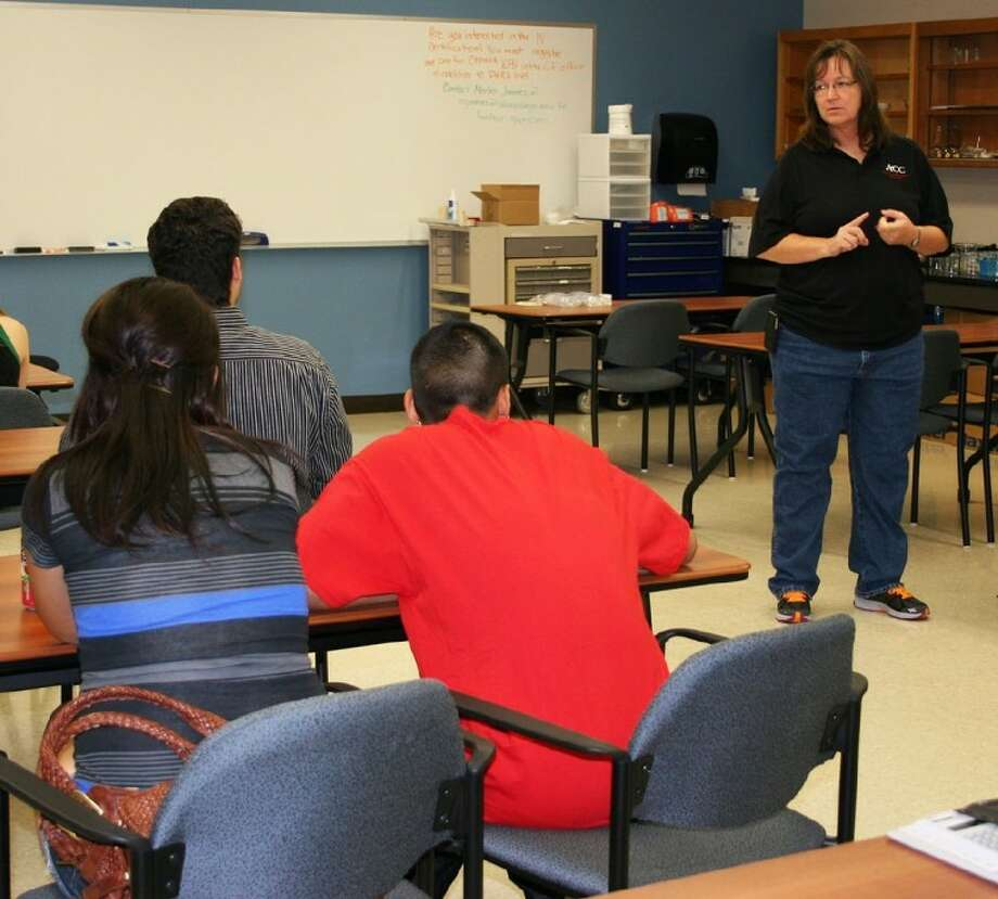 ACC pharmacy technician coordinator Dr. Rhonda Boone speaks to Save Our Seniors students about the pharmacy technician program. Photo: Courtesy ACC