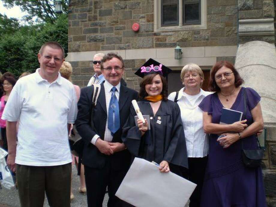 Anna Klis, center, was College Park High School's first valedictorian in 2007. She is pictured after graduating from Georgetown University in May with, from right, her mother, godmother, father and godmother's husband.