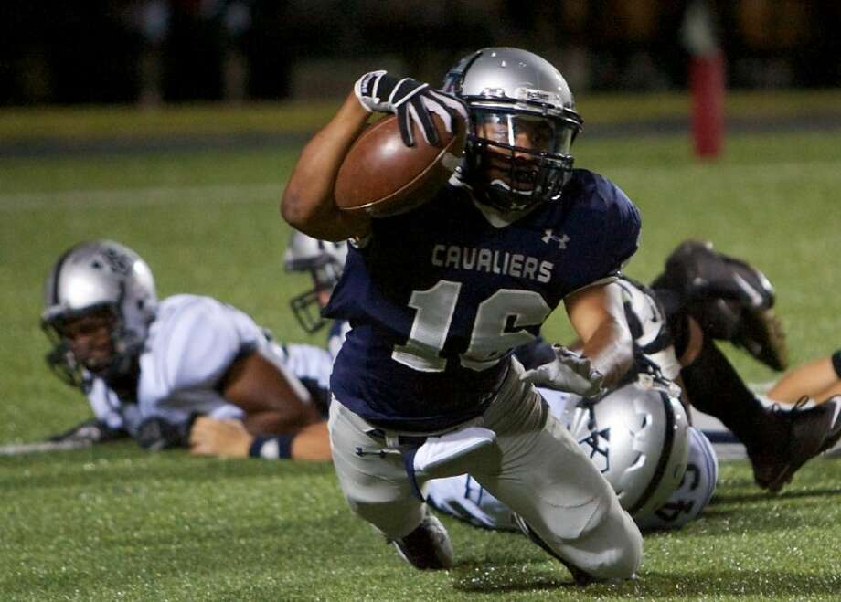 College Park's Nicholas Black reaches out for a first down during Thursday night's game against Clear Brook at Woodforest Bank Stadium in Shenandoah. To view and order this photo and others like it, visit: www.yourwoodlandsnews.com/photos Photo: Staff Photo By Eric Swist