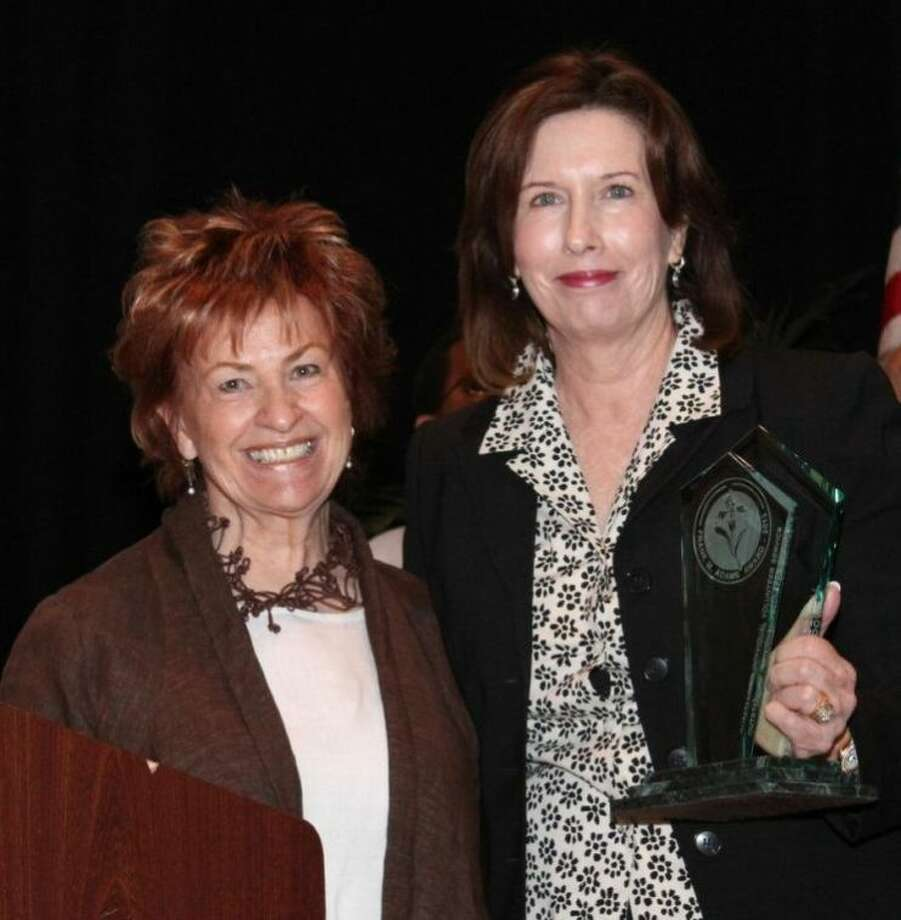 """Photo L to R: Eileen McDowell """"The Art Lady"""" and Texana volunteer with Margaret Jones, Board Member, Texas Council of Community Centers"""