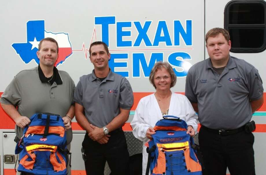 Texan EMS generously donated five medical backpacks to Cleveland ISD campuses. Pictured left to right are Southside Principal Preston Wenz, Melton Bishop, CISD Nurse Valerie Murphy and Ed Thraen. Photo: STACEY GATLIN