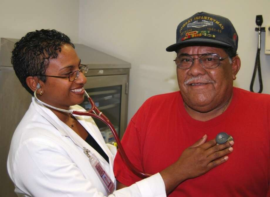 Prime Care Physician Claudine Johnson, M.D. examines Army Veteran Antonio Rosales, Jr. during a recent appointment.