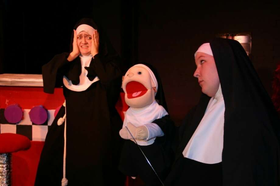 "• Sister Mary Amnesia (Jennifer Henzler) and Sister Mary Annette look on as Sister Mary Leo (Martha Patton) performs her Dying Swan ballet in award-winning Fort Bend Theatre's ""Nunsense,"" Sept. 21 - Oct. 6, at 2815 N. Main, Fridays and Saturdays at 8 p.m. and Sundays at 3 p.m. Tickets are available online at www.fortbendtheatre.com. Group rates are available at 281-208-3333. Photo: Submitted Photo"