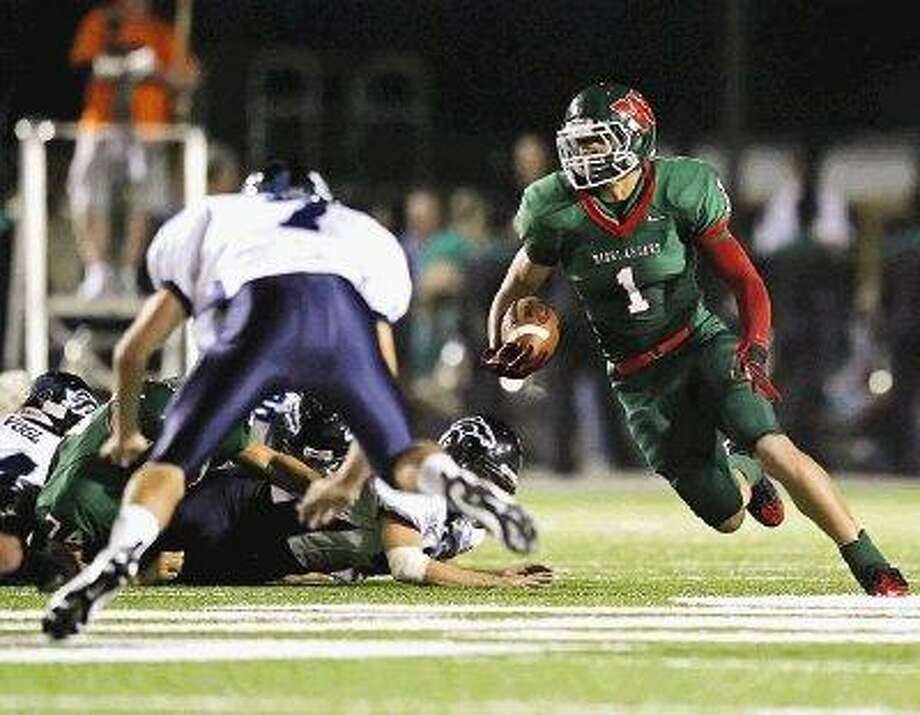 The Woodlands' running back Daniel Lasco gains yards against Kingwood during last year's game at Woodforest Bank Stadium. This year the two teams are in the same district. / The Courier
