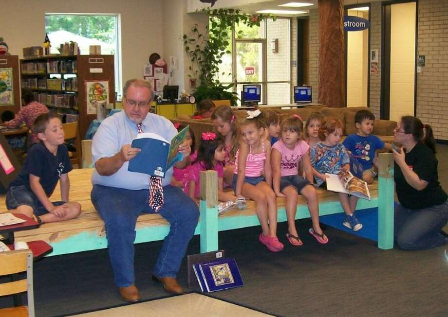 Councilman Otis Cohn was caught reading during the weekly story time program. Cohn was asked by the children to come back and read again.