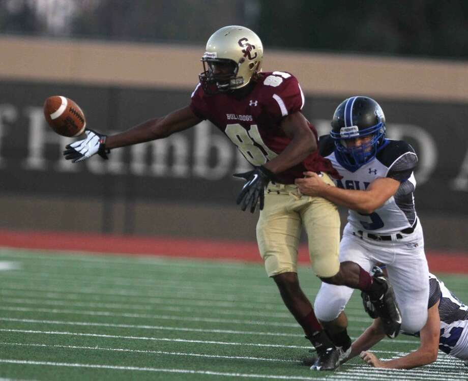 Thoughts: I like the unknown of this image. At this point, you're not sure if he recollected the football before being pull out of bounds or if he lost the ball. In the end, he fumbled the ball, but Summer Creek was able to recover the ball. Caption: Summer Creek wide receiver DeQuann Ruffin (81) fumbles the ball after a hit during a high school football game at Turner Stadium on Sept. 21, 2012. Summer Creek defeated New Caney 64-0.