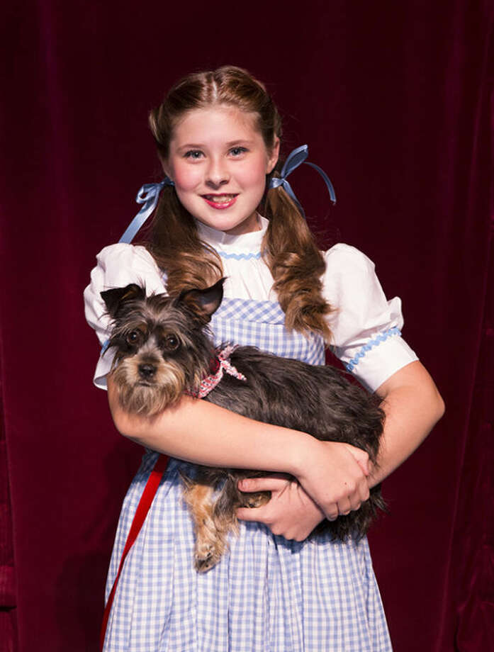 "Cossette Czarnopis as Dorothy with Lizzy as Toto in the Stage Right production of ""The Wizard of Oz."""