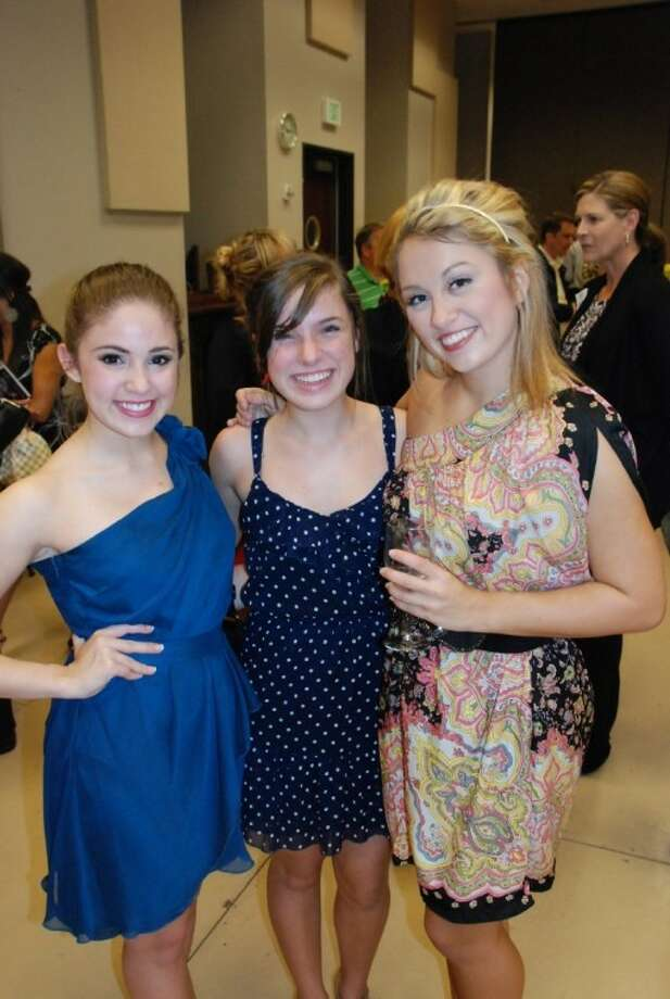 "Bellaire resident and TUTS Humphreys School of Musical Theatre student Natalie Flores, left, joins Grace Nardecchia, sister of a cast member, and Rachel Broussard backstage at a performance of ""Legally Blonde the Musical."" The performance was part of the school's 40th anniversary celebration. Photo: Submitted Photo"