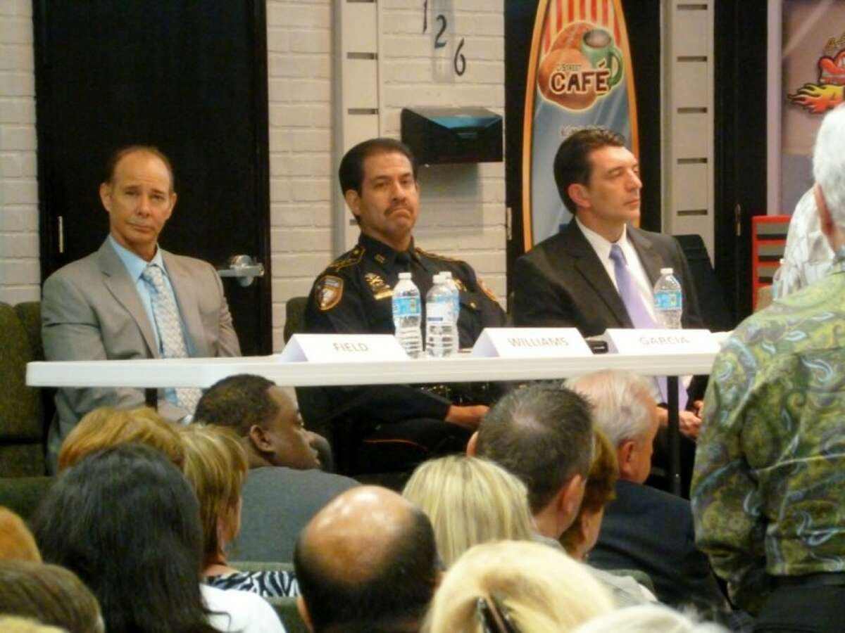 Judge Jeff Williams, Harris County Sheriff Adrian Garcia, Brad Hart with the District Attorney's Office speak to concerned residents during Copperfield Coalition's town hall meeting.