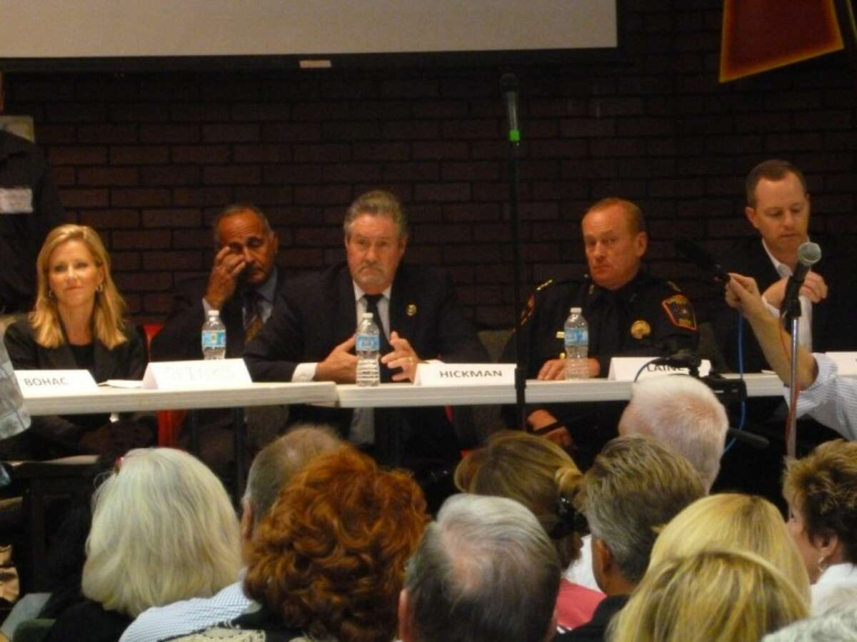 Melissa Spinks with Harris County Attorney Vince Ryan's Office,Ron Hickman, Harris Country Precinct , Precinct 5 Chief Constable John Laine, Chairman of the Crimewatch Committee Sean Walsh particpate in a question and answer session with Copperfield residents.