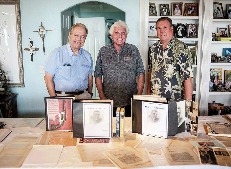 Ray Sherrard, a retired IRS special agent, Marty Dolan, nephew of Treasury investigator Michael Malone, and Wayne McEwan, retired chief of Los Angeles district of IRS criminal investigations, with Michael Malone's case files which, Dolan discovered he had in storage in Laguna Beach, Calif., on September 8, 2016. The three are lobbying for Malone to receive the Presidential Medal of Freedom. Photo: Nick Agro /Orange County Register / Orange County Register
