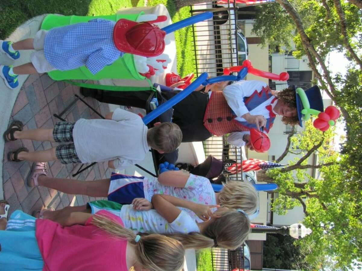 Curly the Clown entertained with balloon creations at the re-opening of Fire Truck Park in Southside Place.