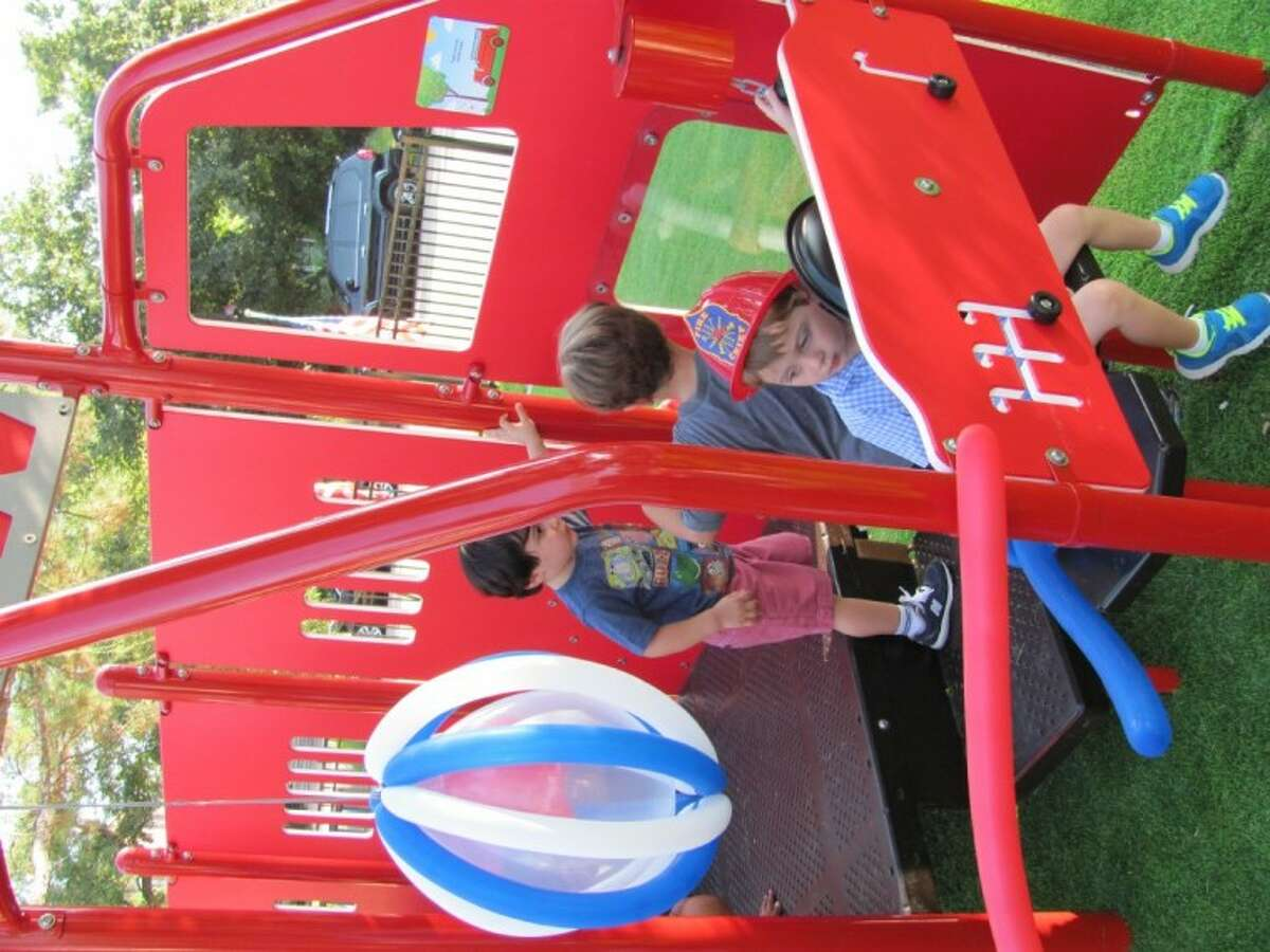 Lucas Archer, son of Courtney and Scott Archer, took a turn at the wheel of the new fire truck play structure at Fire Truck Park.