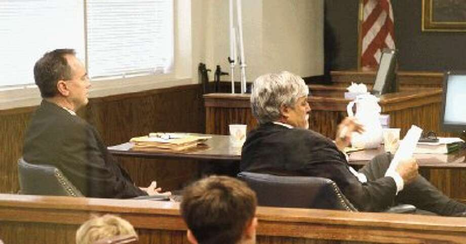 James Alan Jenkins, far left, watches his attorney Audley Heath, of Houston, make a summation during the illegal voting trial Friday.
