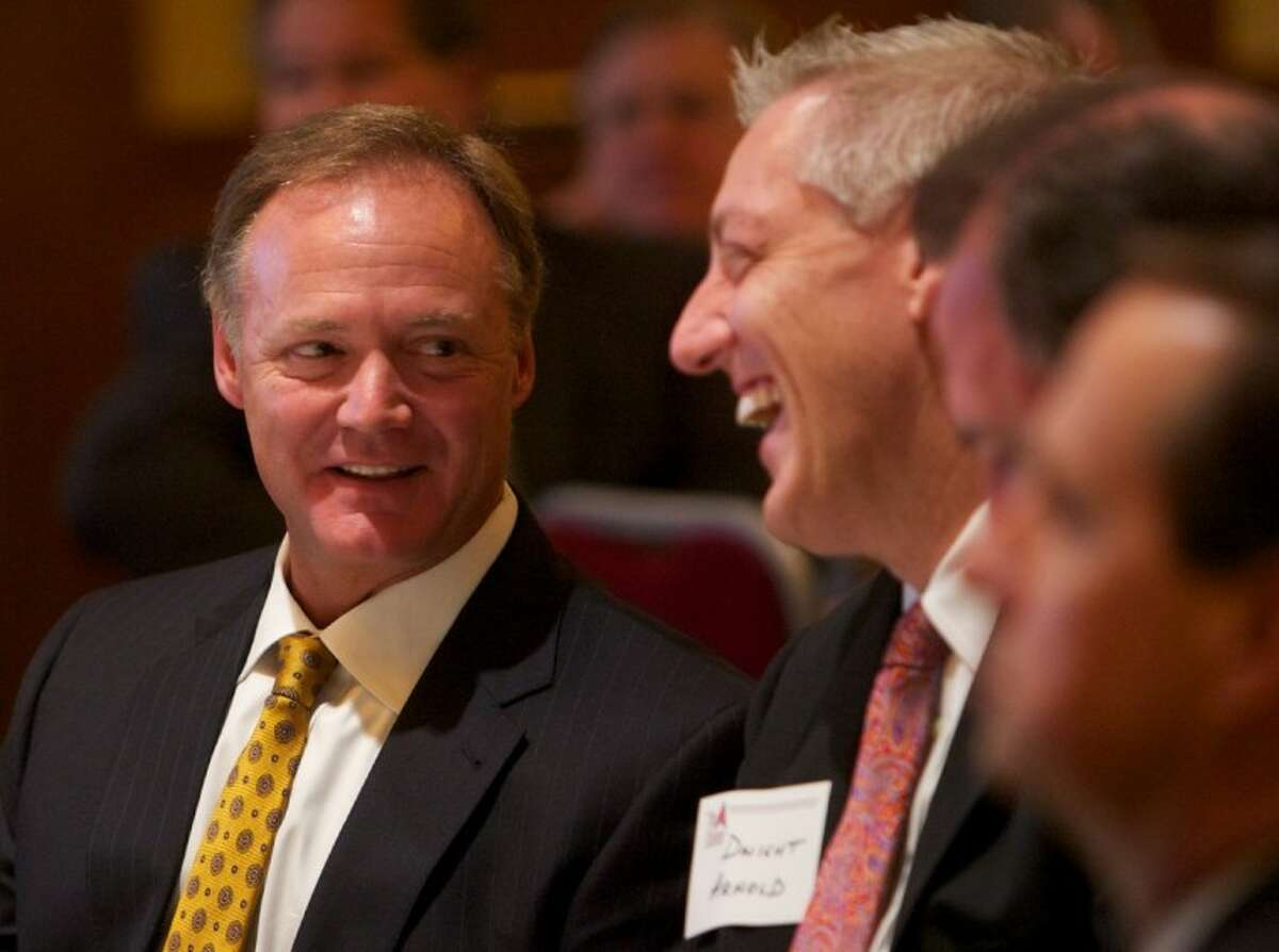 Danny Schroder, left, smiles with friends as he is announced as the 2012 Volunteer of the Year at the South Montgomery County Chamber of Commerce Annual Awards Luncheon at The Woodlands Waterway Marriott last week.