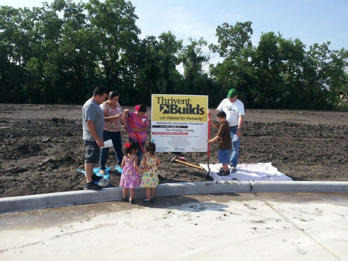 The Hidalgo Family participates in the groundbreaking with Pastor Kelly (Green Hat) from Peace Lutheran.
