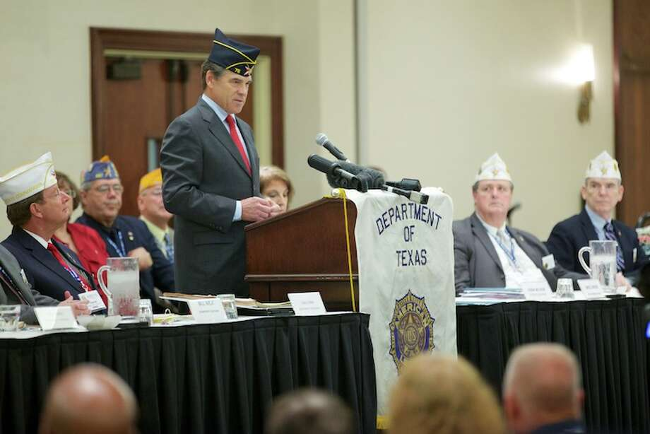 Gov. Rick Perry on Friday highlighted legislation signed into law this session to assist veterans and their families, and discussed the state's efforts to help clear the backlog of Texas-based disability claims made through the Veteran's Administration (VA). The governor spoke at the American Legion Department of Texas Annual State Convention. Photo: Governor's Press Office