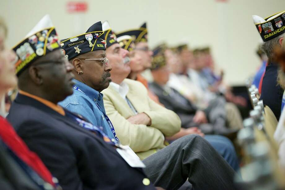 Members of the American Legion listen to Gov. Rick Perry as he addresses the state convention in Dallas on Friday.