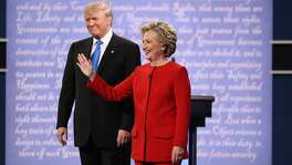 FILE-- Hillary Clinton and Donald Trump take the stage for their first presidential debate, at Hofstra University in Hempstead, N.Y., Sept. 26, 2016. As Election Day approaches in the United States, the Chinese are paying closer attention to the selection of the next president. Government censorship, the language barrier and an unfamiliarity with American political conventions have left many Chinese confused about the process. (Damon Winter/The New York Times)