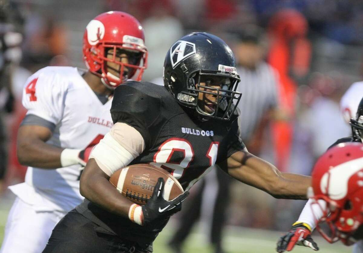 Fort Bend Austin's Bryson Olgesby runs against the Dulles defense during the Bulldogs' 30-26 win Sept. 27 at Mercer Stadium in Sugar Land. Oglesby rushed for 182 yards and the final touchdown.