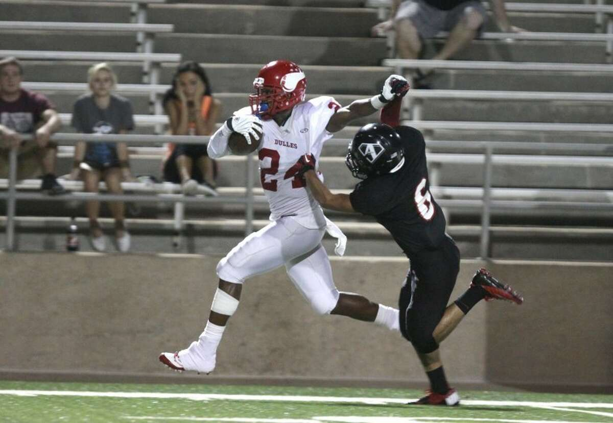Dulles defensive back Maurice Smith stiff-armed two defenders on a 77-yard kickoff return during the Vikings' 30-26 loss to Austin at Mercer Stadium. Smith also caught a touchdown pass and ran for a score.