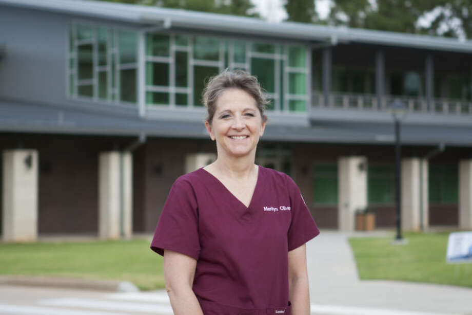 Marilyn Oliver outside the new Lone Star College-Tomball Veterinary Technology facility.