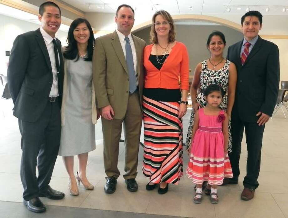 St. Pauls' United Methodist Church appointed three new associate ministers. From left, Rev. Danny Yang and his wife, Susan; Rev. Kim Mabry and her husband, Mike; and Rev. Nataly Negrete and her husband, Jose, and daughter, Mia Grace.