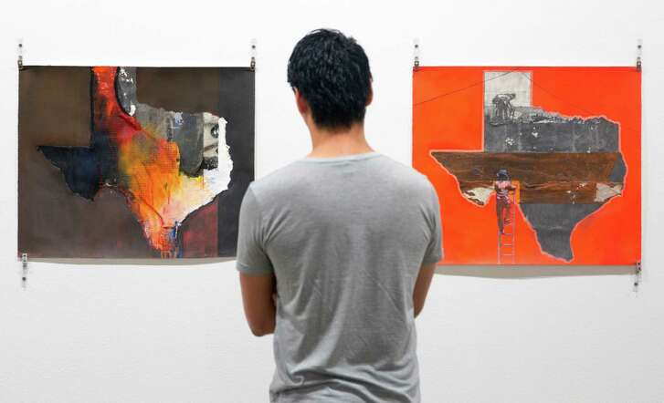 """A person looks works from Raul Gonzalez's """"he Texas Series"""" at a media preview of the """"SATX/MX: Un Viaje Lleno de Cultura,"""" the first exhibit to open at the Centro de Artes building since Texas A&M University-San Antonio left the space and the city took over."""