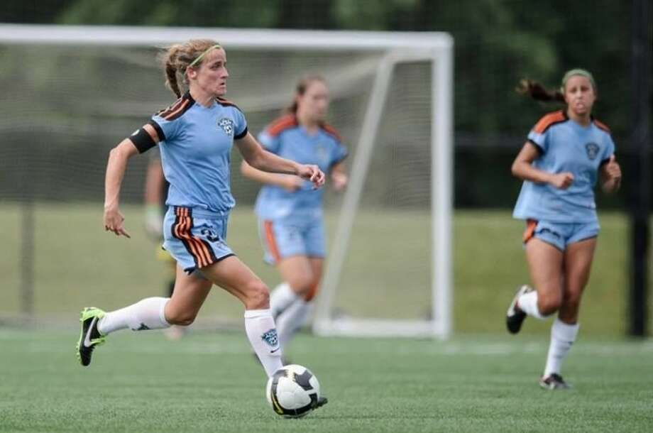 Cy Woods girls' soccer coach Lauren Prewitt is pictured playing for the Houston Aces of the Women's Premier Soccer League. The coach is still active on the pitch as one the team's leaders. Photo: Courtesy Photo