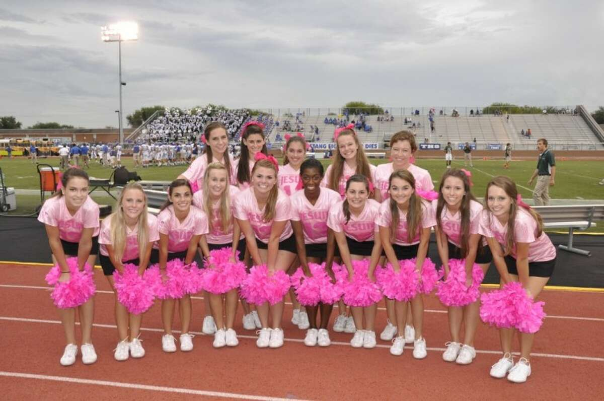 Members of the Strake Jesuit cheerleading staff are wearing pink all through the month of October for Breast Cancer Awareness month.