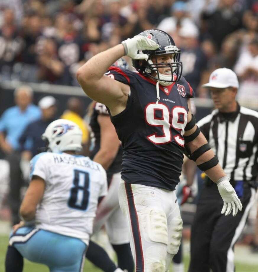 J. J. Watt salutes after sacking Tennessee Titans quarterback Matt Hasselbeck during the Texans' 38-14 triumph. Watt will host his first Charity Classic softball game April 27 at Constellation Field.