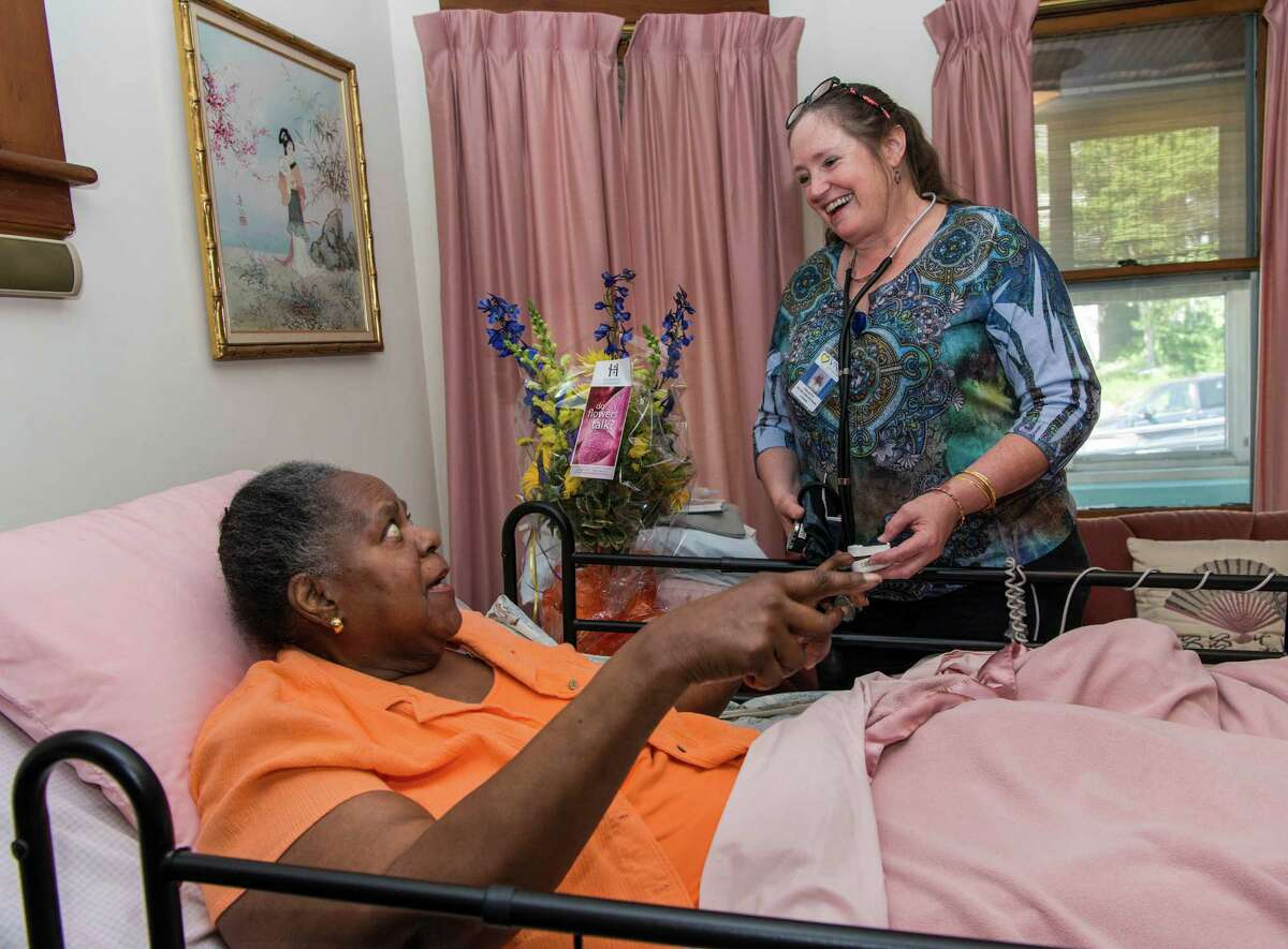 Virginia Oliver gets a visit at her home in Bridgeport from Collette Sengupta of the Visiting Nurse Services of Connecticut on June 24. With this visit the Visiting Nurse Services of Connecticut reached the 10 million patient care visits mark.