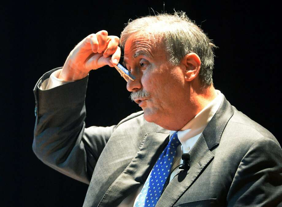 Larry Sabato, a political science professor at the University of Virginia, demonstrates one possible technique to be used while voting in November. Photo: Chris Dorst, Associated Press