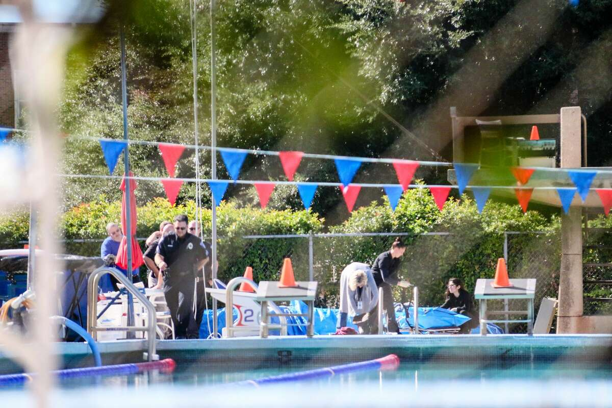 Authorities investigate a body found in a campus pool at Southern Methodist University on Sept. 29, 2016.