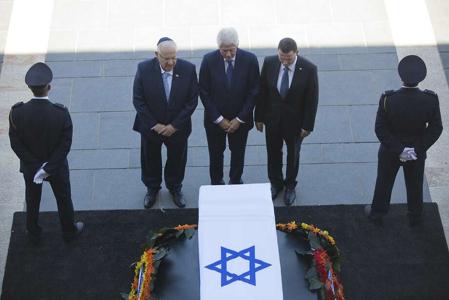 Former President Bill Clinton, accompanied by Israel's President Reuven Rivlin (left) and Yuli Edelstein, the speaker of the Knesset, pays respects at Peres' coffin in Jerusalem. Photo: Oded Balilty, Associated Press