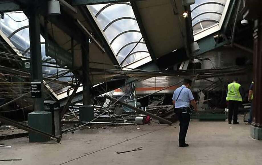 This Thursday, Sept. 29, 2016 photo provided by a passenger who was on the train when it crashed shows wreckage at the Hoboken, N.J. rail station. The commuter train barreled into the station during the morning rush hour, coming to a halt in a covered area between the station's indoor waiting area and the platform. (AP Photo) Photo: Associated Press