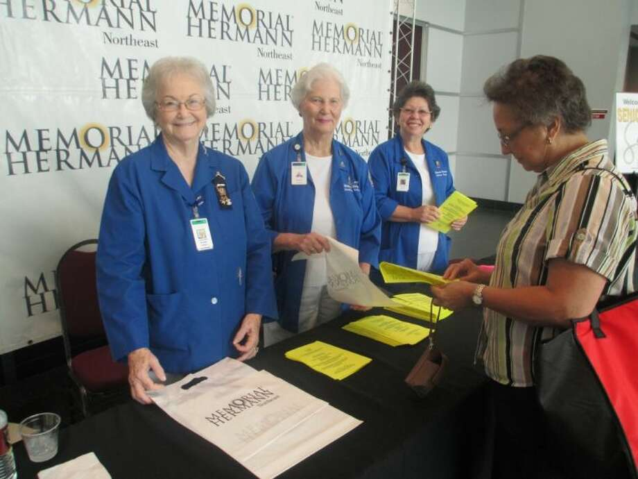 Memorial Hermann Northeast Hospital Volunteers from left, Evelyn Peek, Paula McCreary and Maria Johnson welcomed attendees to last year's Senior Health Fair. The Northeast Volunteers will again be helping out at this year's Sept. 24 Health Fair at the Humble Civic Center.