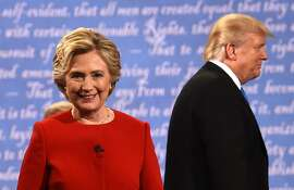 TOPSHOT - Democratic nominee Hillary Clinton (L) and Republican nominee Donald Trump leave the stage after the first presidential debate at Hofstra University in Hempstead, New York on September 26, 2016. / AFP PHOTO / Timothy A. CLARYTIMOTHY A. CLARY/AFP/Getty Images