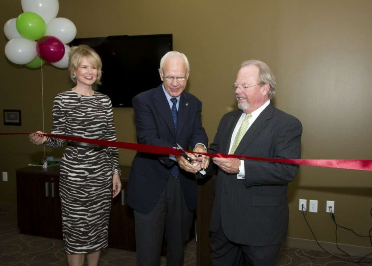 From left, Suzan Deison, president and CEO of the Greater Houston Women's Chamber of Commerce, District G Councilman Oliver Pennington and George Smith, M.D., president of Senior Products for Humana's Southwest Region, cut the ribbon on Humana's first Guidance Center in Houston on Thursday, Sept. 27. The Guidance Center - located at Woodlake Shopping Center on 9664 Westheimer - is open to anyone in the community and provides fitness classes, seminars, social activities and assistance with health plans.