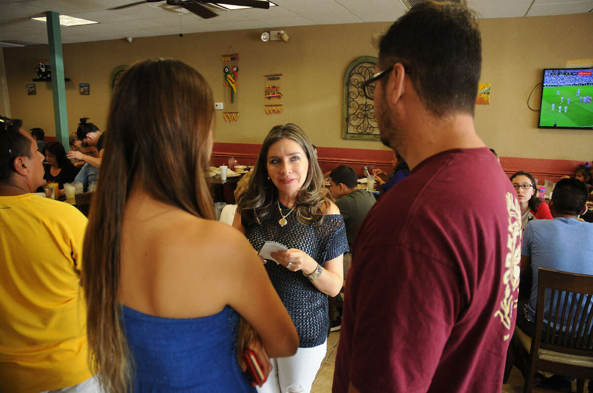 Gran Colombia restaurant owner Liliana Gonzales seats customers on Sept. 18, 2016.
