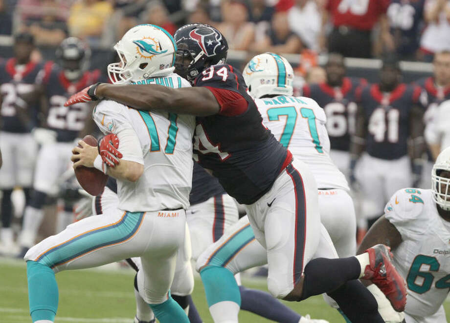 Houston's Antonio Smith sacks Miami quarterback and Texas A&M product Ryan Tannehill Aug. 17 at Reliant Stadium in Houston. The Texans won the preseason game 24-17.