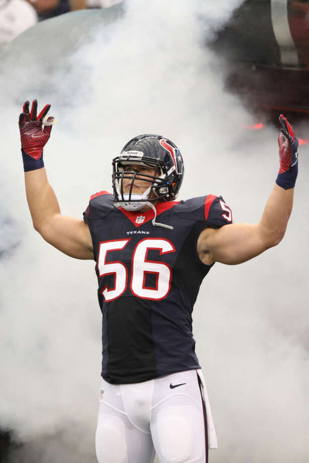 Houston's Brian Cushing comes out of the tunnel against Miami for his first game since his knee injury last season Aug. 17 at Reliant Stadium.