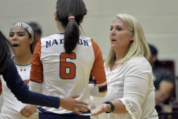 Madison coach Shannon Wolfe talks to her players during a District 26-6A high school volleyball match against MacArthur on Oct. 6, 2015, at Littleton Gym in San Antonio.