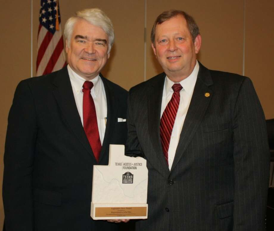 Senior Texas Supreme Court Justice Nathan Hecht (left) presents State Rep. John Otto with a Texas Access to Justice Legislative Hero Award during the Oct. 4 luncheon of the Greater Cleveland Chamber of Commerce at the Cleveland Civic Center.