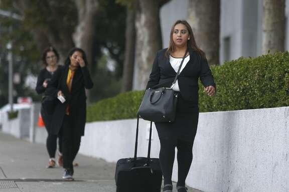 Attorney Elizabeth Camacho walks from the Public Defender's office around the corner to the Hall of Justice in San Francisco, Calif. on Thursday, Sept. 29, 2016. Camacho immigrated to the United States from Mexico with her family when she was 10 and just recently became a U.S. citizen in time to vote in this year's election.